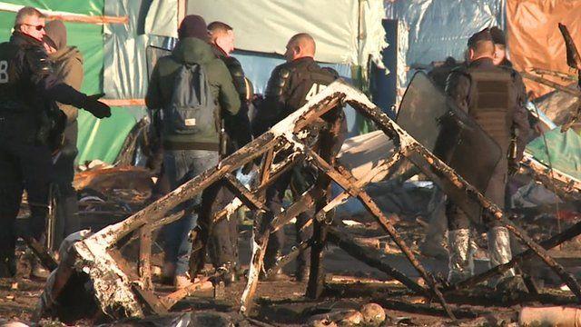 Police at Calais migrant camp