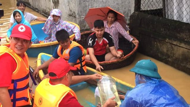 Red Cross volunteers are using small boats to reach people in need of aid