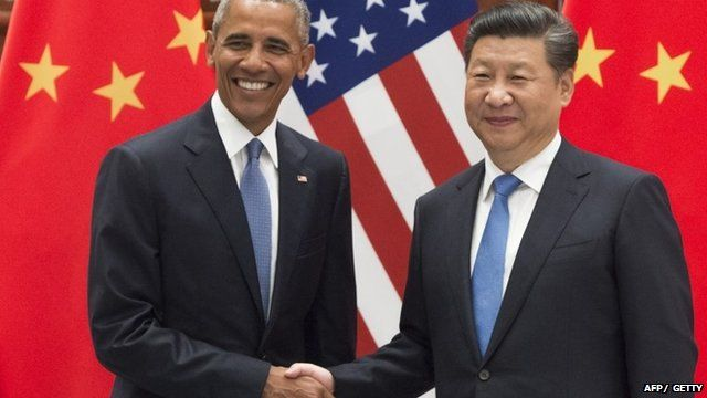 Chinese President Xi Jinping (R) and US President Barack Obama (L) shake hands