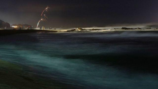 Revellers launch fireworks from Jeongdongjin beach in Gangneung, Ganwon-province, South Korea