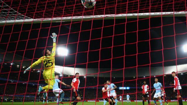 John Stones score Manchester City fourth goal past goalkeeper Brad Jones of Feyenoord during the UEFA Champions League group F match