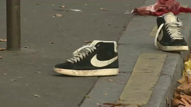 Trainers in street outside Bataclan concert hall