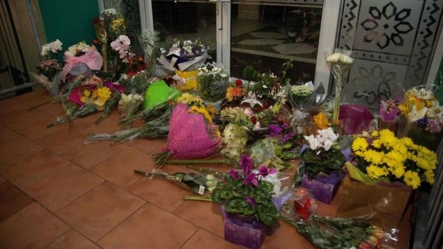 Flowers are placed on the front steps of the Wellington Masjid mosque in Kilbirnie in Wellington on 15 March 2019