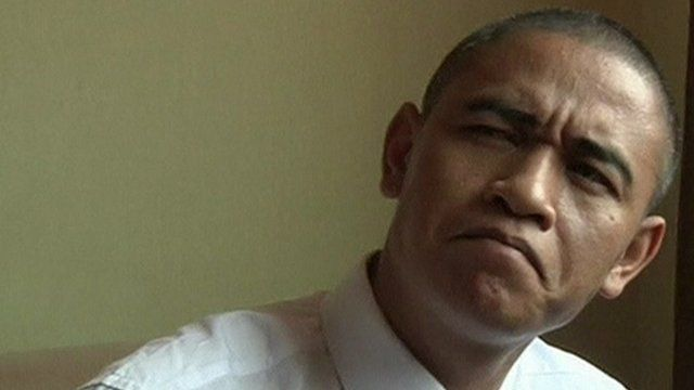 Barack Obama impersonator Xiao Jiguo demonstrates one of his 'Obama' looks