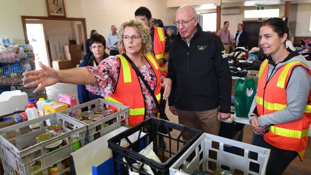 Governor-General of Australia David Hurley speaks to people at a bushfire relief centre in Bairnsdale, East Gippsland, Victoria, 05 January 2020.