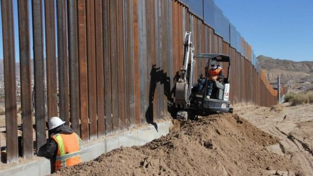 Workers are pictured along the border line between Mexico and the US in Ciudad Juarez, Mexico on 25 January 2017