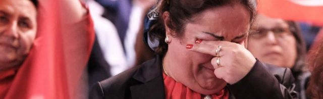 A woman weeps at a Republican People's Party meet in Berlin