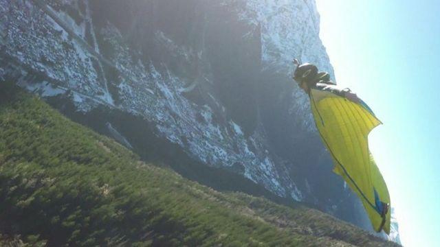 A wingsuit base jumper in Chamonix, France