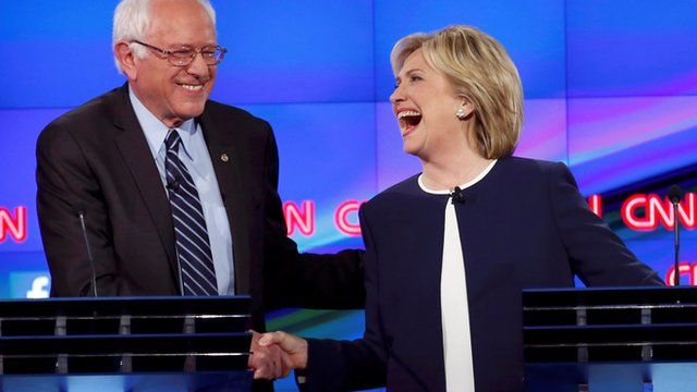 Bernie Sanders and Hillary Clinton shake hands