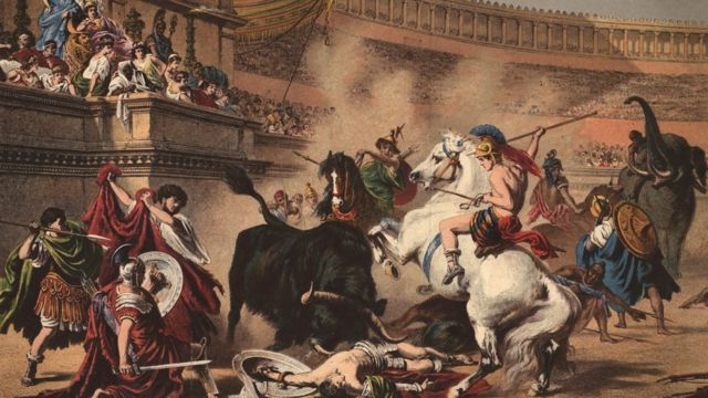 gladiadores montados en elefantes y caballos en un anfiteatro romano.