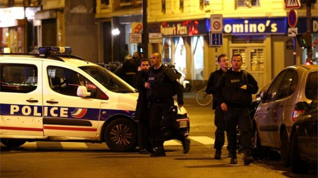 Police officers arrive at the scene of a shooting in Paris France 13 November 2015