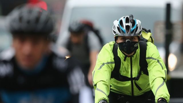 A cyclist wearing a breathing mask in central London