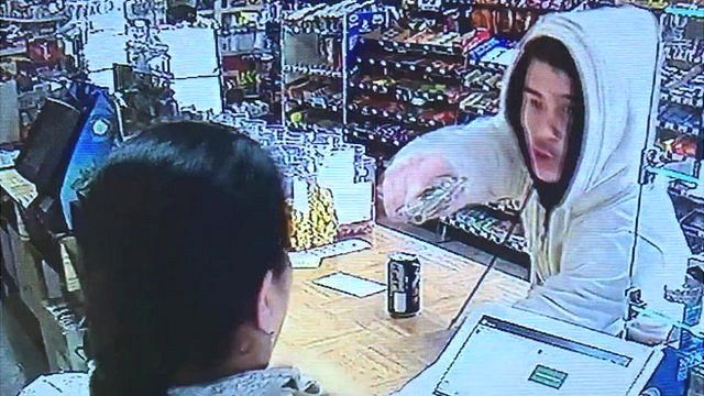 Armed robber points gun at cashier
