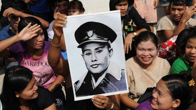 Supporters of Aung San Suu Kyi hold aloft a portrait of her father, General Aung San, in 2012