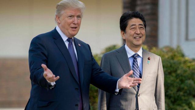 President Donald Trump with Japan's Prime Minister Shinzo Abe at the Kasumigaseki Country Club Gold Course in Tokyo on 5 November 2017