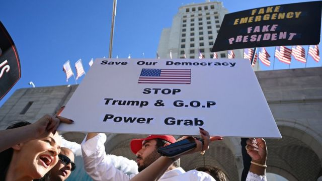 People protest against Donald Trump's National Emergency declaration, February 18, 2019, outside City Hall in Los Angeles