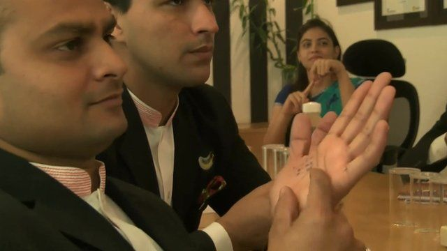 Indian businesspeople learning sign language