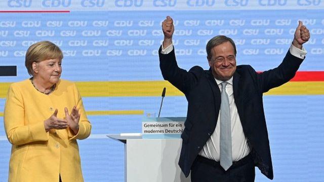 CDU leader Armin Laschet (right) and Angela Merkel.