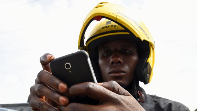 A motorbike taxi rider in Nigeria