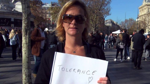 Woman holding pad displaying the word 'tolerance'