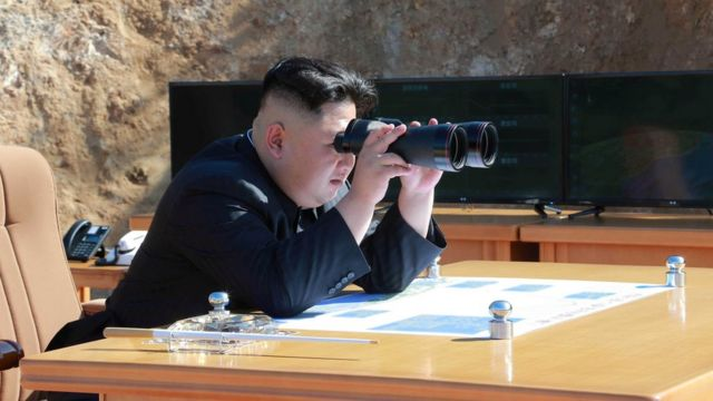 North Korean Leader Kim Jong Un looks on during the test-fire of inter-continental ballistic missile Hwasong-14 in this undated photo released by North Korea's Korean Central News Agency