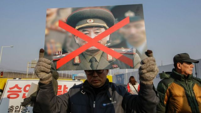 South Korean sunken ship Cheonan victims family members rally against North Korean vice chairman Kim Yong Chol visit near the Unification Protester hold with tear off North Korean Flag at Unification Bridge near Panmunjom in Paju, South Korea, on 25 February 2018