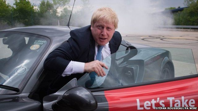 "Boris Johnson emerges from a Ginetta sport car after the company's Chief Executive Lawrence Tomlinson performed a series of ""doughnuts"" as the former Mayor of London visited the factory in West Yorkshire"