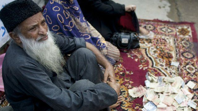 Abdul Sattar Edhi collects donations at a roadside in Peshawar, Pakistan, in 2010