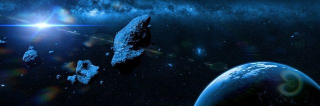 Artist's interpretation of an apocalyptic situation - a swarm of asteroids moving towards planet Earth