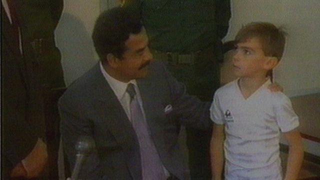 Stuart Lockwood y Saddam Hussein