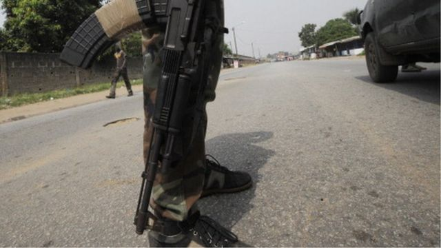 Close up of a soldier from Ivory Coast's Republican Forces as he stands guard near the paramilitary police barracks in the Yopougon district in the west of the city of Abidjan on December 21, 2012.