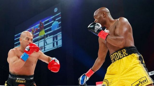 Tito Ortiz and Anderson Silva square off during the first round of the fight during Evander Holyfield vs. Vitor Belfort presented by Triller at Seminole Hard Rock Hotel & Casino on September 11, 2021 in Hollywood, Florida.