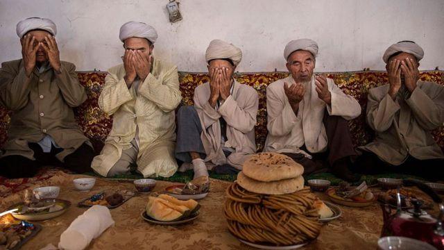 Uigures en Xinjiang.