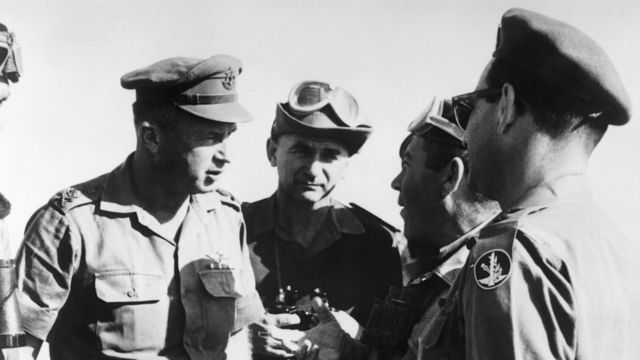 Israeli army chief of staff Yitzhak Rabin (L) confers with his officers during military manoeuvres in the Neguev in May 1967