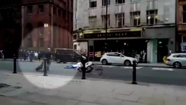 Man throwing a homeless person's belongings in to the road