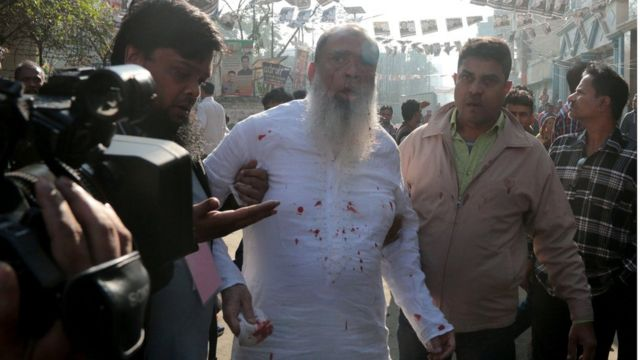 Salahuddin Ahmed, a Bangladesh Nationalist Party (BNP) candidate for general election, is seen bleeding