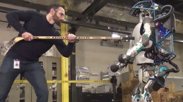 Robot is prodded by human