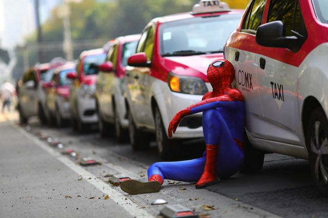 A person dressed up as Spider-Man