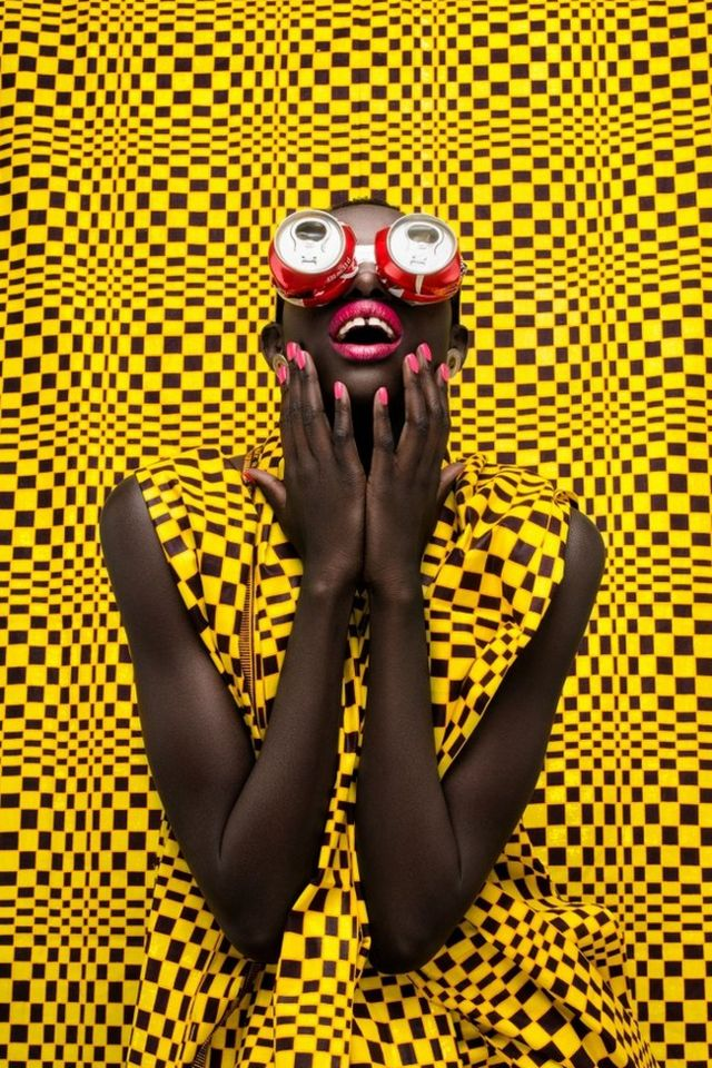 Woman with Coke cans as eyewear