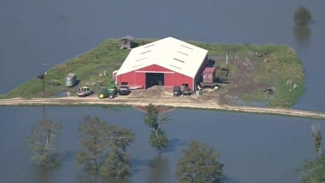 Texas farm building surrounded by floodwater