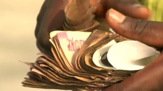 Counting Nigerian currency