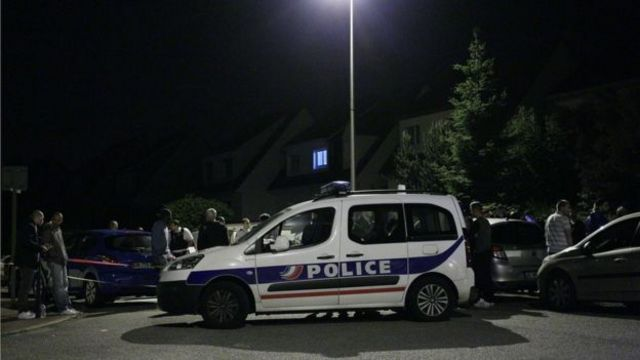 The suspect attacked the policeman before entering his house and taking his partner and child hostage, witnesses said