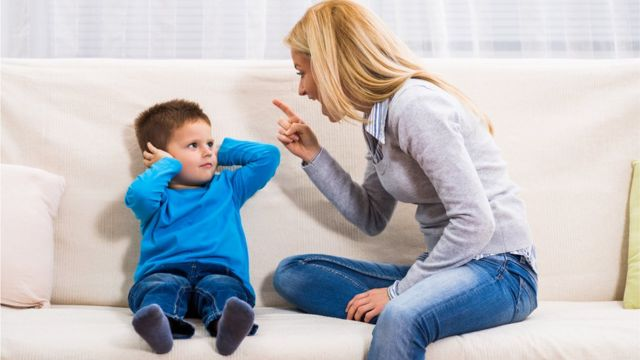 Parent telling of a child, pointing her finger