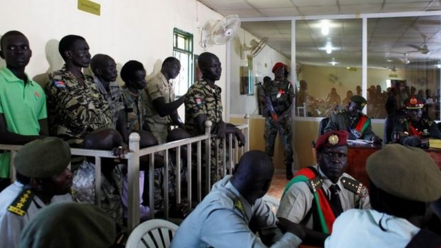 South Sudanese soldiers stand during their sentencing over the rape of foreign aid workers and the murder of a local journalist in an assault on the Terrain Hotel in the capital Juba in 2016 at a military court Juba, South Sudan, September 6, 2018.