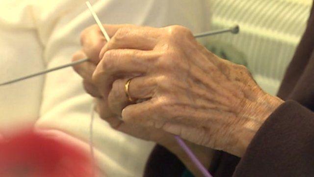 Elderly hands knitting