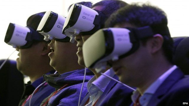 "Visitors try Samsung""s Gear VR virtual-reality goggles shown at the Mobile World Congress in Barcelona"