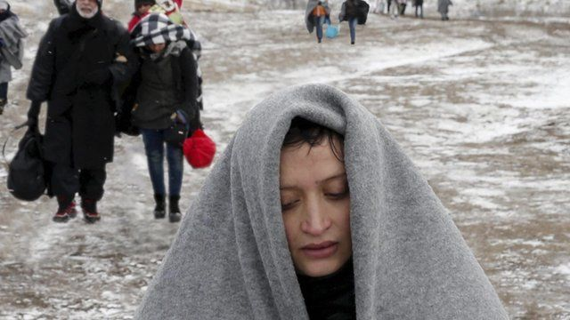 A refugee at the Turkish / Syrian border