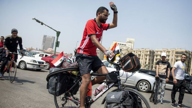 """Mohamed """"Ibn Nufal"""" Nufal on top im bicycle as e dey start im journey"""