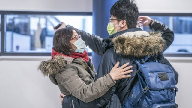 Tourists wearing face masks arrive to Lapland at Rovaniemi airport in Rovaniemi, Finland, 01 February 2020
