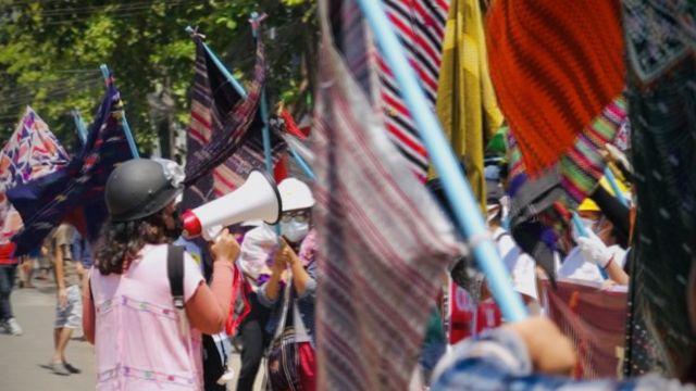 Protestors using sarongs as flags in Myanmar